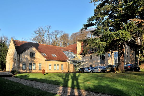 the modern office building of Forrester Lodge in a green and tranquil surroundings and private parking in front