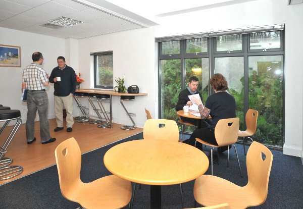 Inside the Forrester Lodge kitchen area where tenants of the modern office building are meeting and drinking coffee