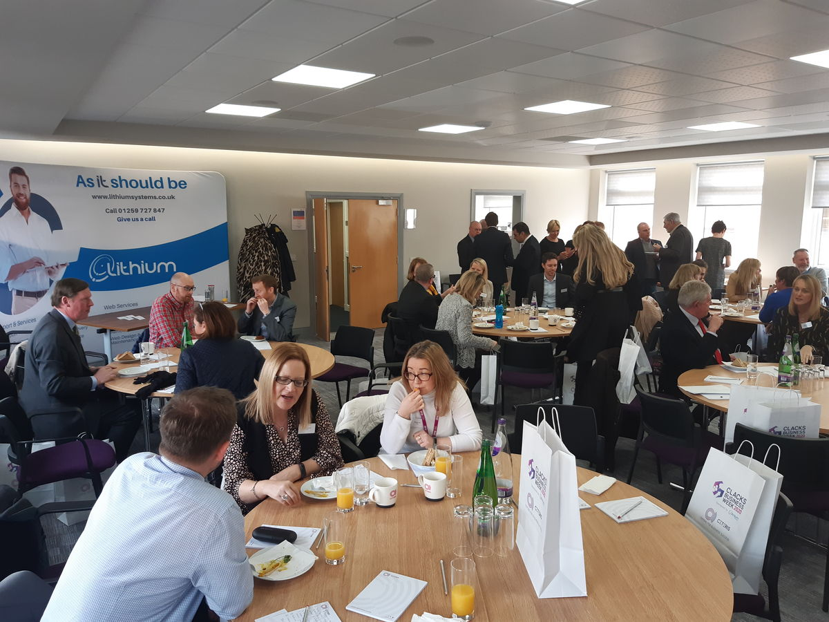 A busy room of business people networking at Clacks Business Week