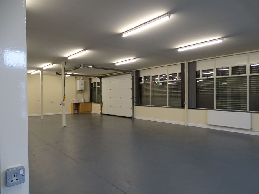 Spacious and well-lit area inside an industrial trade unit at The Trade Centre in Alloa