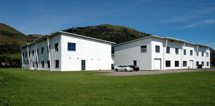 Corner view of two modern office buildings in Central Scotland, at Hillfoot business village in Alva, with the Ochil Hills behind