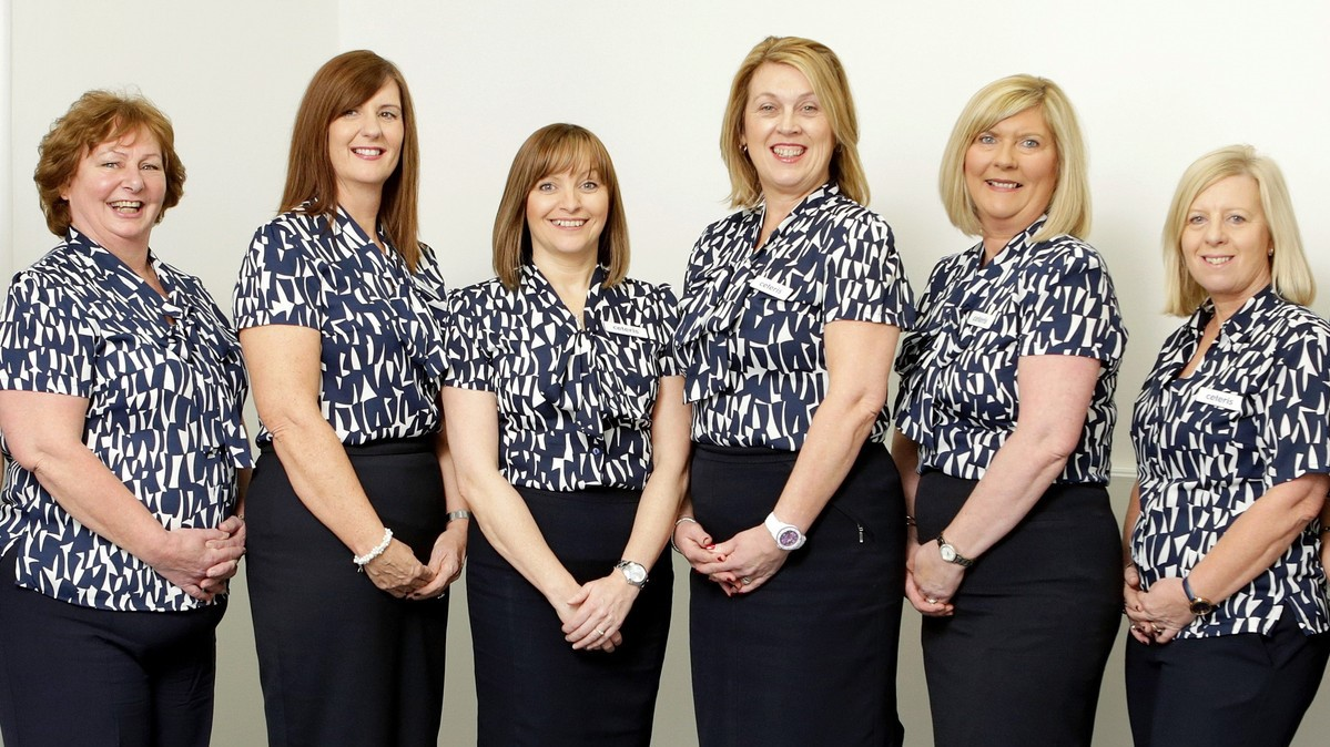 The Ceteris reception team standing in front of a neutral background